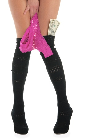 Female legs with panties and money photo