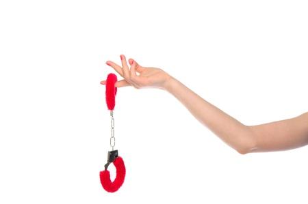 セックス ゲームの手錠で女性の手