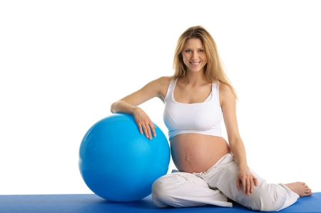 Pregnant woman excercises with gymnastic ball Stock Photo - 9869900