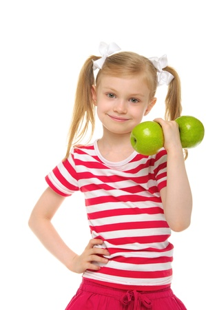 pleasantness: Girl trains fitness dumbbells from apples Stock Photo