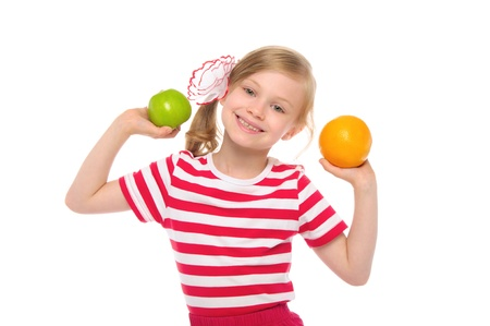 emote: Happy girl with orange and apple Stock Photo