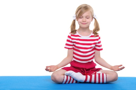 girl with eyes closed practicing yoga Stock Photo