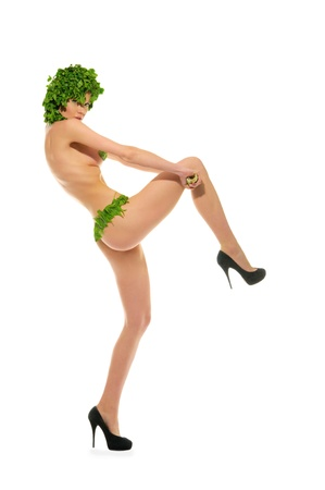 dancing woman with clothes madeof vegetables isolated on white photo