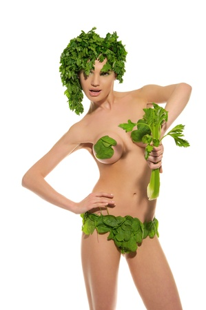 sexy woman with clothes made ??of vegetables photo