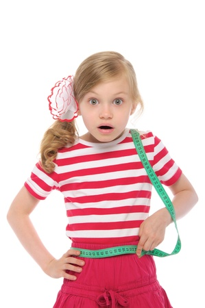 surprised child: Surprised girl measuring her waist Stock Photo