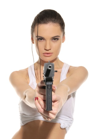 Young sexy woman with gun