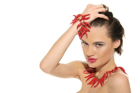 Sexy woman with jewelry of red hot pepper photo