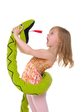 animal screaming: girl fights with toy snake Stock Photo