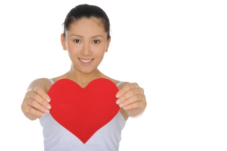 denote: beautiful Asian woman holds out the heart