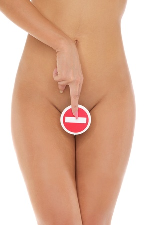 woman holds sign of the genitals prohibiting