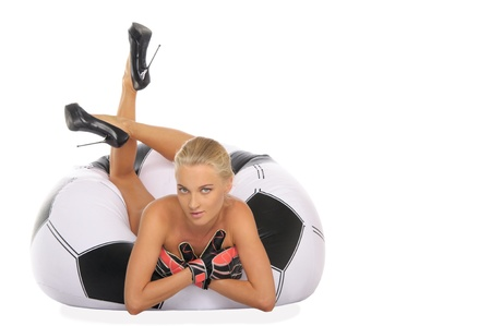 Woman with gloves in chair of soccer ball photo