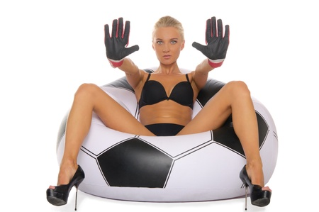 Woman with gloves in chair of soccer ball Stock Photo - 10261691