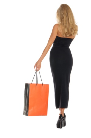 beautiful woman with orange shopping bags Stock Photo - 10261767