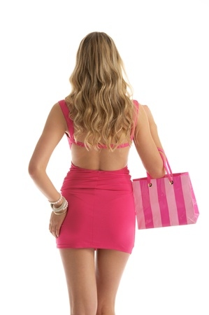 beautiful woman with rosy shopping bags photo