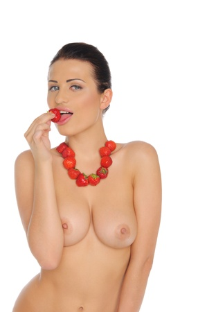 Sexy woman bare chest with jewelry from strawberry photo