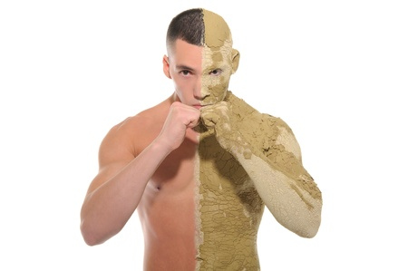 young man half smeared with clay Stock Photo - 10634260