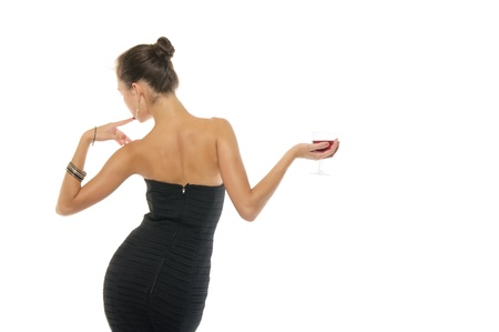 Beautiful woman in dress with glass of wine Imagens