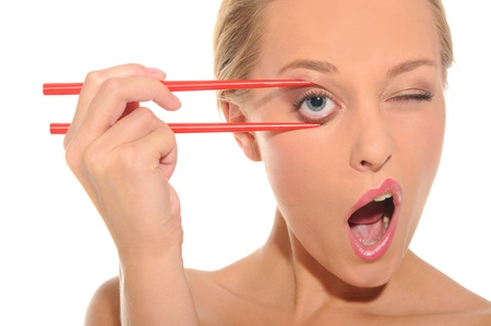 unexpectedness: Surprised woman opens her eyes chopsticks