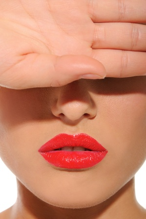 red lips: woman with red lips closes his eyes with hand Stock Photo