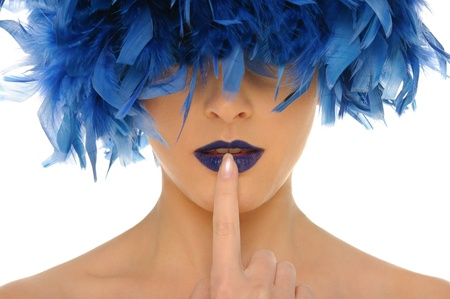 woman with blue feathers lips and closed eyes photo