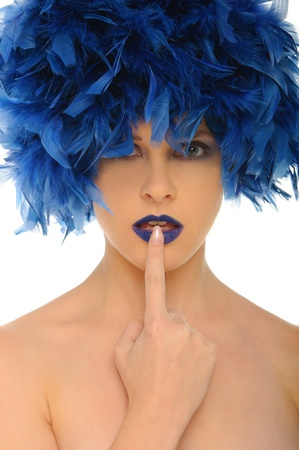 woman with blue feathers lips and open eyes photo