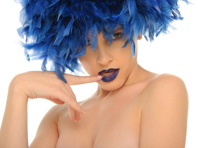 beautiful woman with blue lips and feathers photo