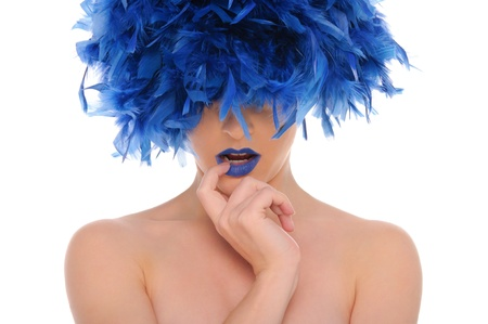 woman in blue feathers with closed eyes photo