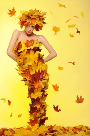 woman in dress of leaves and defoliation photo