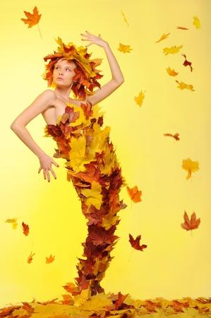 defoliation: woman in dress of leaves and defoliation