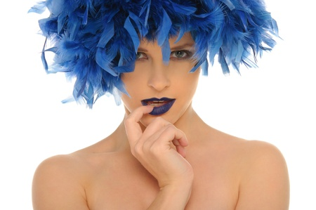woman in blue feathers with open eyes photo
