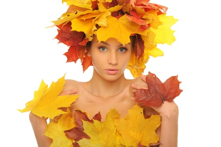 Beautiful woman with autumn leaves photo