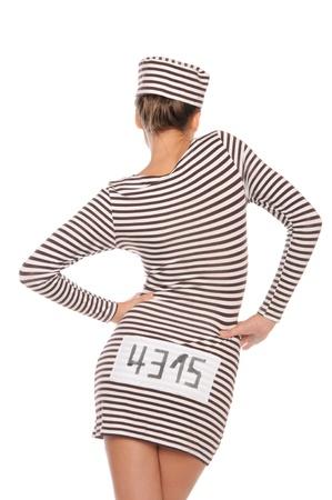 後ろからの囚人のための縞模様のドレスの女性