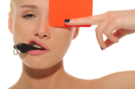 beautiful woman with whistle and red card photo