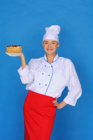 pleasantness: happy woman- cook holding cake Stock Photo