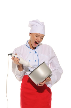 bawl: Dissatisfied woman chef  with blender and pot Stock Photo