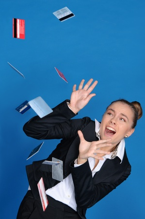 unexpectedness: frightened businesswoman with falling bank card