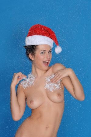 femme nue avec des flocons de neige et de Noël chapeau Banque d'images - 11790459