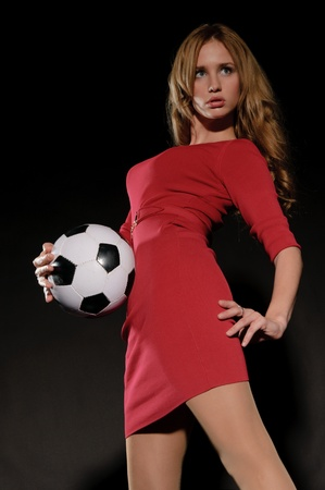 beautiful woman in dress with soccer ball Stock Photo - 11790448