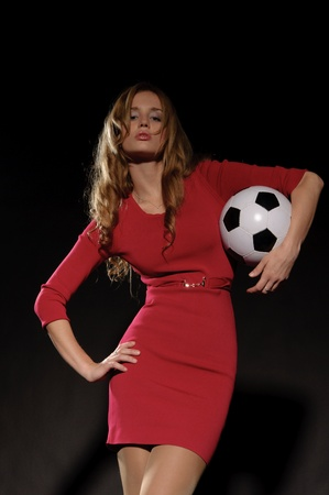 beautiful woman in dress with soccer ball photo