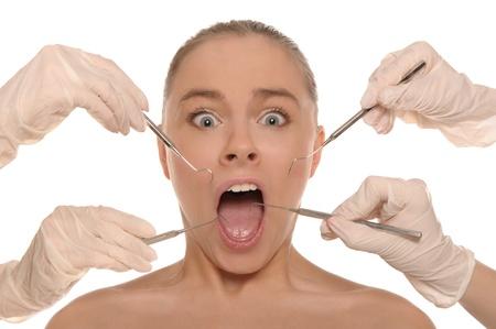 口: 歯医者のレセプションでおびえた女性 写真素材