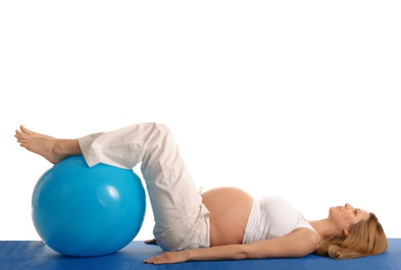 pleasantness: pregnant woman practicing yoga with blue ball