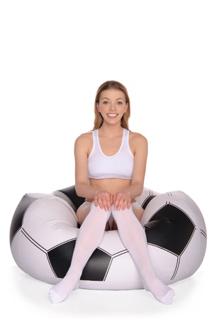 woman on an inflatable soccer chair photo
