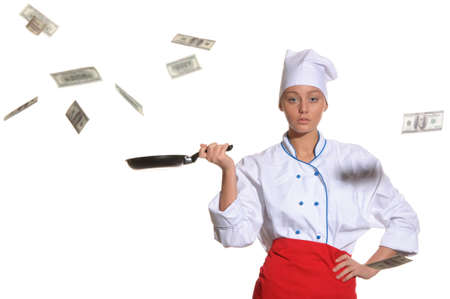 woman-cook frying pan catches money isolated on white photo