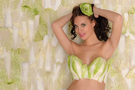 green cabbage: beautiful pregnant woman in lingerie from cabbage
