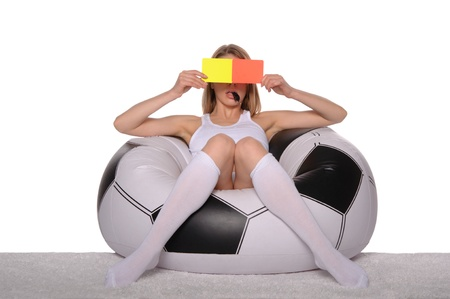 Football supporter with red and yellow cards photo