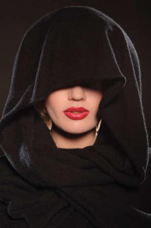 portrait of beautiful woman in cape