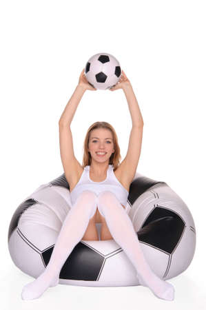 woman with soccer ball on an inflatable chair photo