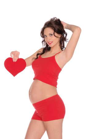 hermosa mujer embarazada en rojo con el corazón Foto de archivo - 12801857