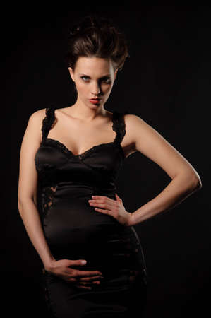 beautiful pregnant woman in black dress photo