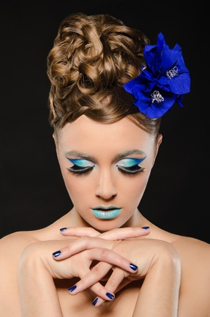 Vertical portrait of woman with blue make-up Stock Photo - 12802015